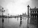 View of the lagoon from Piazzetta San Marco in the rain. The monolithic column topped by a statue of the Lion of St. Mark and the Church of Santa Maria della Salute are clearly visible