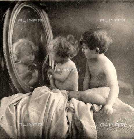 two nude children play in front of a mirror bovi michele rosenberg